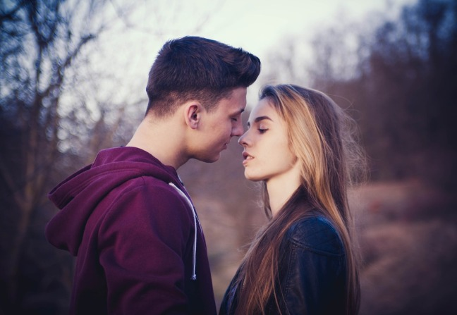 couple almost kissing